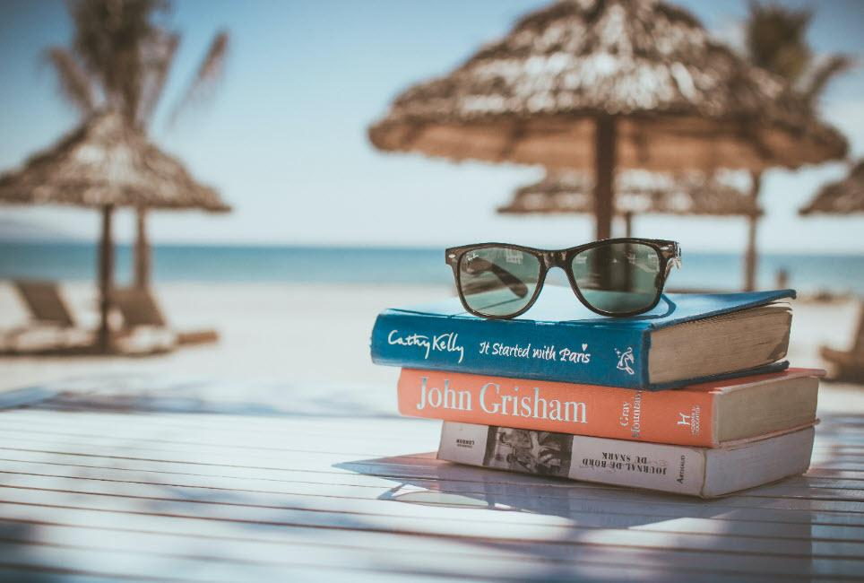 book stacked on a beach
