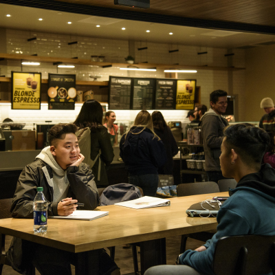 image of students at the Starbucks inside Payson Library