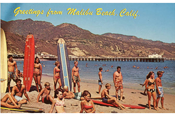Historic photo of surfers and beach goers from 1960.