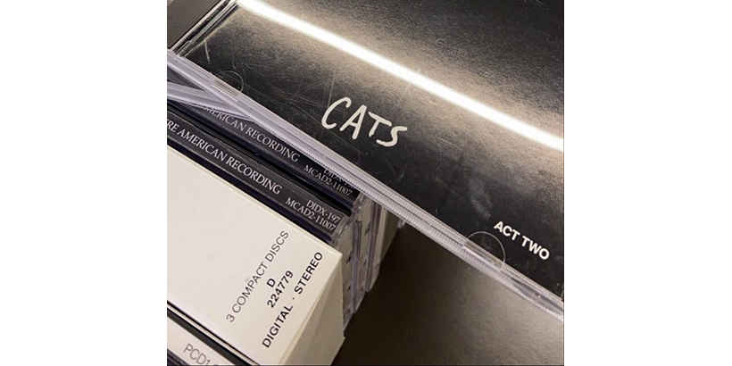 Image of stack of CDs, with Cats displayed on top.