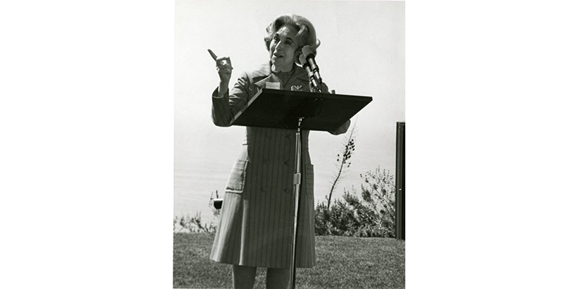 Image of Margaret Brock at a podium.