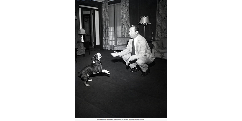 President Hugh Tiner with his pet dog, circa late 1940's