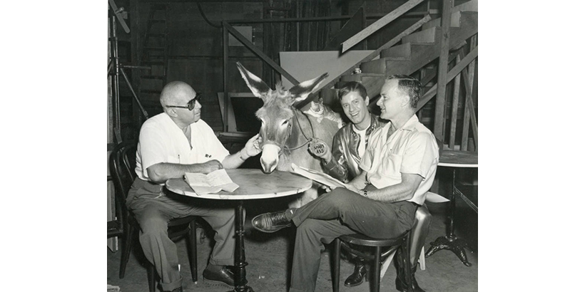 "Micky Moore with a donkey and cat on the set of ""Visit to a Small Planet"" with Norman Taurog and Jerry Lewis"